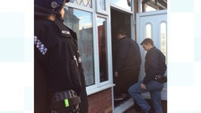Officers entered an address this morning to make the arrests.