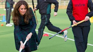 The Duchess of Cambridge plays hockey during a visit to her former preparatory school St. Andrew's, near Pangbourne southern England.