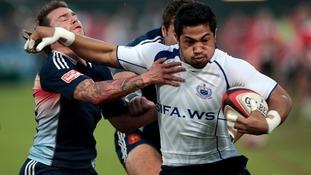 Samoa's Robert Lilomaiava fights for the ball against France's Terry Bouhraoua in the Sevens World Series Cup semi-final rugby match.