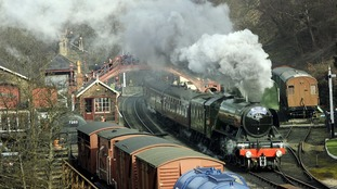 The Flying Scotsman steams through Goathland station, made famous in the Heartbeat TV series, in the North York Moors National Park.