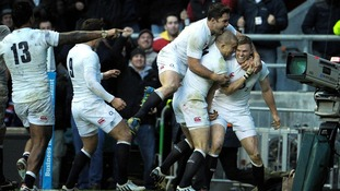 England's Chris Ashton celebrates a try during the QBE International at Twickenham Stadium, London.