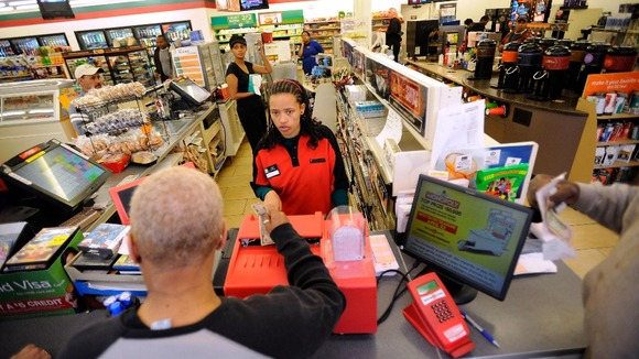 Dinkensh Dubiyo sells a ticket at the Baltimore 7-Eleven store where one of the winning lottery tickets was sold.