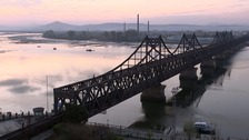 A train crosses the bridge between China and North Korea.