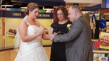 Mark and Anne exchange rings and vows at the Spam Museum