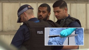 Police detain a man, and inset, a knife.
