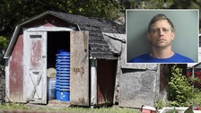 Woman 'held captive' in pit in neighbour's garden shed
