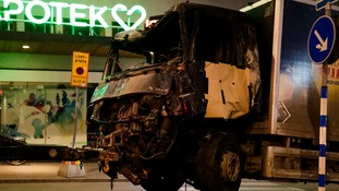 Shoppers were sent screaming in panic as the hijacked lorry ploughed into crowds in Stockholm.