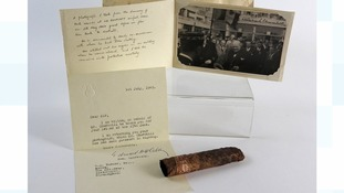 A cigar half smoked by Britain's wartime leader Sir Winston Churchill and associated photograph and letter sold for £1,700.