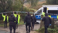 The victim was discovered burned in luggage in a lay-by just off the A628, near Tintwistle, Derbyshire