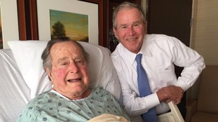 George HW Bush with his son, former President George W Bush.