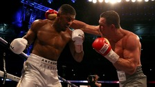 Joshua (left) in action against Wladimir Klitschko