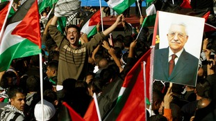 Palestinians celebrate the UN General Assembly's upgrading of their status