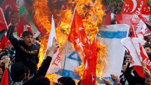 Supporters of the Saadet (Felicity) Party burn an Israeli flag as they shout anti-Israel slogans during a protest in Istanbul.