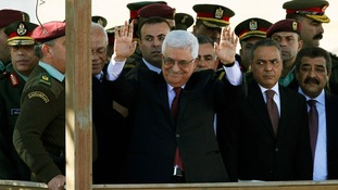 Palestinian President Mahmoud Abbas waves to the cheering crowds in Ramallah