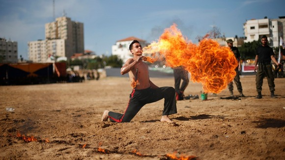Member of Hamas&#x27; national security forces demonstrates his skills at the site of a destroyed security compound in Gaza.