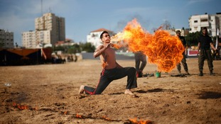 Member of Hamas' national security forces demonstrates his skills at the site of a destroyed security compound in Gaza.