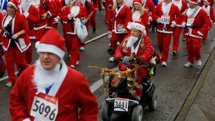 Runners dressed in Santa Claus outfits compete in the annual Santa Dash in Liverpool.
