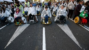 People in wheelchairs take part in a rally against government cutbacks for disabled people in Madrid.