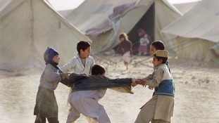 Children play at a refugee camp on the Afghanistan/Pakistan border