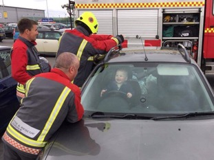 Little Brandon Green beamed as the fire service got to work rescuing him