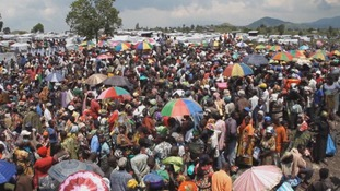 People crowd waiting to hear their names called for aid distribution
