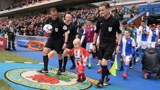 Young football fan with rare cancer leads out teams at Ewood Park