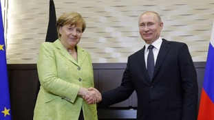 Putin urged by Merkel to protect gay rights
