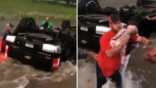 Rescuers save baby and toddler from overturned car in rushing Texas floodwater