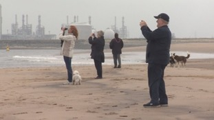 Onlookers as the Brent Delta arrives on Teesside