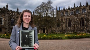 Clara Woolford, Project Curator at Auckland Castle Trust with a photo of Ernest Alexander.