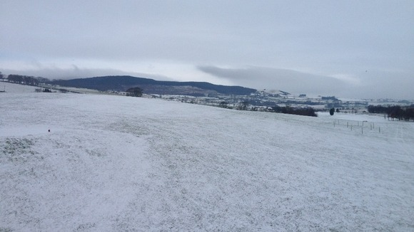 Across Rothbury Golf Course with Simonside Hills in the background