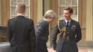 The PM's address came after she visited Buckingham Palace, where she was greeted by the Queen's equerry Wing Commander Samuel Fletcher.