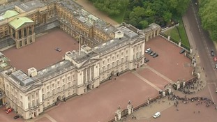 The prime minister's car is seen being driven into the centre of the Palace's quadrangle.
