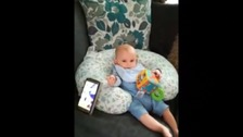 Noah listens to his Dad's voice through the ipad.