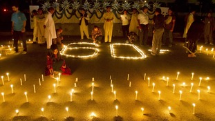 Participants in Islamabad, Pakistan take part inn Earth Hour