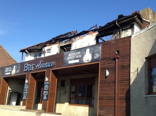 Extensive damage to the roof of the bar