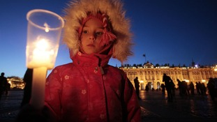 A child lights a candle in St Petersburg