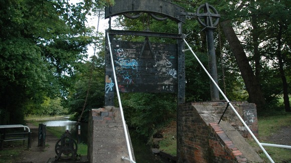 The lock gate has been damaged by vandals over the years