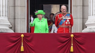 The royal couple on Buckingham Palace during the Queen's 90th birthday celebrations.