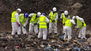 Police search a landfill site for Corrie