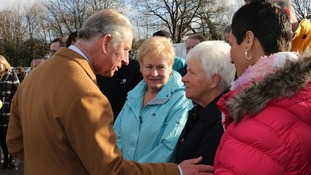 The Prince of Wales talks with flood victim Jenny Jones