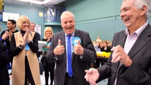 One Conservative candidate celebrates after winning his seat.