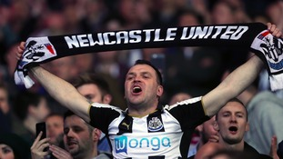 Newcastle United fans in the stands during the Sky Bet Championship match at The Cardiff City