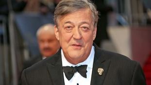 Stephen Fry poses for photographers at the BAFTA awards earlier this year.