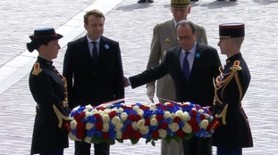 Emmanuel Macron and François Hollande lay a wreath to those killed in WWII.