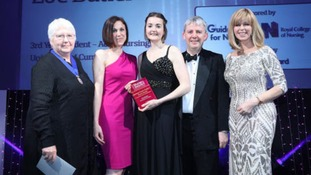Zoe Butler (centre) collects her award