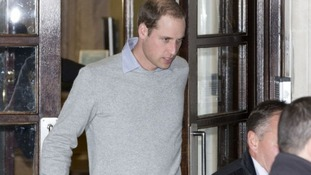 Prince William leaves the King Edward VII hospital in central London after visiting his pregnant wife