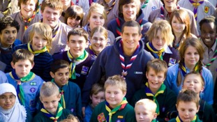 Adventurer and Chief Scout Bear Grylls with young Scouts