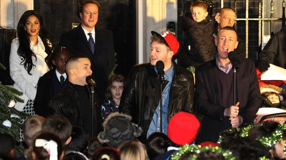 David Cameron watches the X Factor finalists singing outside Number 10