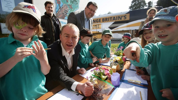 Mr Farron at a primary school in Cornwall.